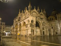 Basilica di San Marco - Venice, Italy - At night. San Marco at night can put a visitor back centuries. The only sound is the click of heel by the occasional pedestrian and that of the water lapping at the nearby dock.