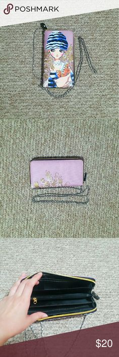 Wallet/clutch Cute pink cartoon drawing wallet. I got this as a gift years back and never used it. Comes with a long metal chain to carry around (chain is detachable). The wallet has multiple card slots, slots for your money, and a zippered coin purse. Great to gift to a young cousin, sister, friend or whomever! Bags Wallets