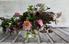 Bouquet includes: grapes, coleus, amaranth, dahlias 'Bracken Rose', 'Twilite', and 'Crossfield Ebony', black queen anne's lace, scabiosa, basil, copper beech, black elderberries, lisianthus, scented geranium 'Chocolate', wheat, nine bark 'Coppertina', and thornless blackberries.