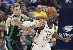 Scoring Basketball Academy - Boston Celtics Daniel Theis (27) and Indiana Pacers Damien Wilkins battle for a loose ball during the first half of an NBA basketball game, Saturday, Nov. 25, 2017, in Indianapolis. (AP Photo/Darron Cummings) - TSA Is a Complete Ball Handling, Shooting, And Finishing System!  Here's What's Included...