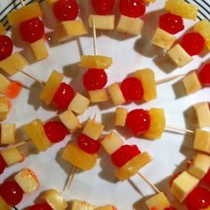 Mama does these for every function!!! Several variations, though....Cherries, mozerella cheese squares, and pineapple OR sharp cheddar cheese squares with green olives!!! LOVE THEM!!!!