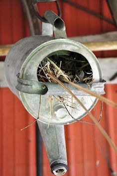Watering Can Birdhouse - PetDIYs.com  Use a watering can as a birds nest! Drill through the bottom of a watering can to attach it to a wall, fence post or tree or hang the birdhouse by its handle.