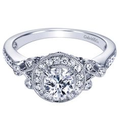 A 14k White Gold Victorian Halo Engagement Ring.