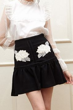 Iris Flower Patch Ruffle Skirt Discover the latest fashion trends online at storets.com #skirts #patchskirts #ruffleskirts #flowerpatchs #flowerpatchskrts