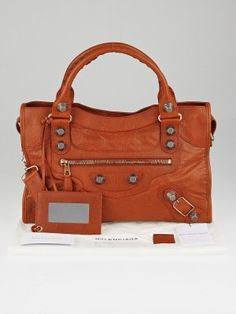 Balenciaga Orange Brulee Lambskin Leather Motorcycle City Bag. Last known retail price was $1895.