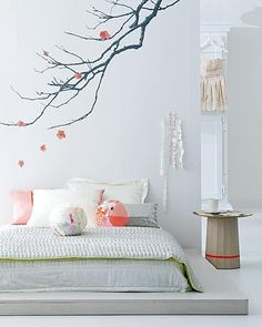 Japanese bedroom with photo wallpaper and peach-pink accessories