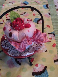 Ribbon cupcake..love the rosette on top