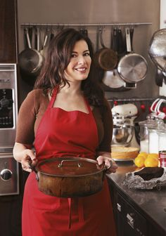 Nigella Lawson... A home cook, not a chef but who cares?  She cooks real food and loves to eat.  Her motto:  Food is NOT the enemy! :)