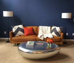 Modern living room just waiting for a great piece of art to complete the new look.  Arcturus Studio Interior Design