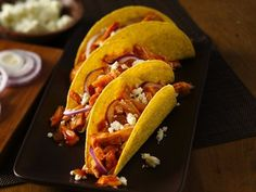 Chicken Tinga Tacos Recipe - http://www.omahamoms.com Great way to use leftover rotisserie chicken, shredded and mixed with enchilada sauce and served in taco shells!  Quick and easy mexican dish recipe