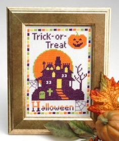 """""""Trick Or Treat"""" is the title of this Halloween cross stitch pattern from Tiny Modernist, Inc."""