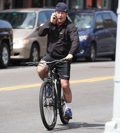 Get off the phone, Alec. Alec Baldwin takes his bicycle for a spin in NYC
