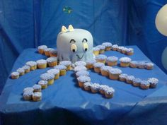 Octopus Cake..center cake for Eli to destroy and cupcake tentacles for all the guests