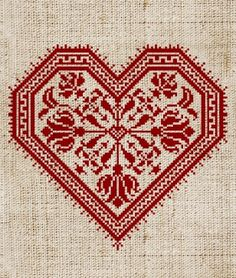 Cross-stitch heart - this might actually make me want to take up cross stitch again - I really like the fabric it's stitched onto: