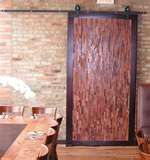 i2i Designs.  Love the idea of using barn doors to separate space.  This one uses 12 different types of wood.  Easy to put up track.