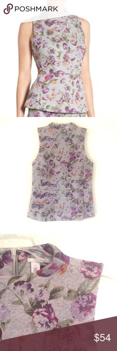 Halogen Peplum Top New. Never worn. Look subtle and chic in this floral grey peplum top by Halogen. Dress up or dress down. Looks awesome either way. 100% cotton. Fabulous fit. Hidden zipper extends 3/4th of the way down the back of the top. The fabric is thick and structured. See pic 3 for thickness. Size: Small. Comes from a smoke free home. Reasonable offers will be accepted :) Halogen Tops