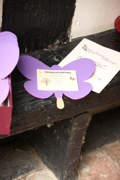 My DIY Order of Service and music booklet :) Purple and pink card cut into a Butterfly with a lolly stick for the guests to hold :)