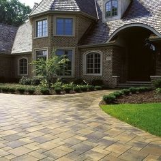 A paver driveway can be a big boost to curb appeal; an enormous array of design choices are readily available. Although it's more expensive than some other materials to install, a paver driveway carries relatively low long-term maintenance costs and can last 30 to 40 years.