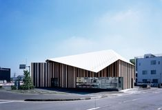 kengo kuma gently folds roof canopy over animal hospital in japan