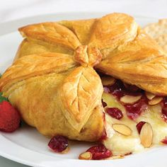 This pastry-wrapped soft cheese, topped with cranberries, apricots and almonds, is great for the holidays but it can also be served year-round.