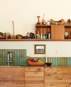Beauty in imperfection: Note the irregularly positioned cabinet pulls in the kitchen.