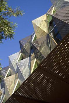 Perforated custom metal facade. Statement feature at Yanget House. Artist, Designer, Photographer: Rick Verney