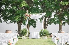 This bride wanted to rent our willow arch for her wedding on the river. She wanted a gauzy backdrop with an asymmetrical spot of complimentary flowers. https://www.facebook.com/WilliamsburgFloral/