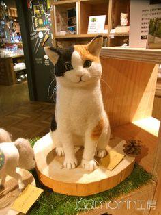 Felted cat sculpture