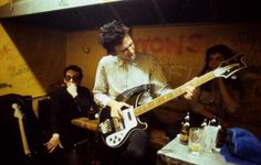 Richard Hell and Elvis Costello backstage at CBGB, photo by Roberta Bayley.