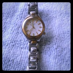 """Two-tone Guess Waterpro Watch Two-tone gold and silver watch.  Face measures 1"""" x 1.25"""".  Stainless steel.  Water-resistant up to 50 meters. Some fading on gold areas on band (see pics). Guess Jewelry"""