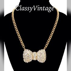 Gorgeous gold & Diamond bow necklace 18 inches- large gold tone chain - rhinestone encrusted bow . Beautiful shimmering Boutique Jewelry Necklaces