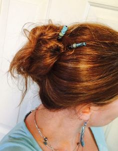 Kalani hair sticks with a fun splash of turquoise, gray, and white! Great in your messy bun style. She Glows in Lilla Rose!