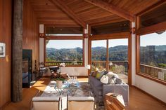 Spa bathrooms, digital infrastructure, all-day light and postcard views define this four-bedroom Midcentury occupying nearly a third of an acre.  Several decks and a stone patio with built-in barbecue serve as outdoor spaces, while the lot readily accesses hiking and biking trails.  Mount Tamalpais appears to sit just off the living and dining rooms, and downtown San Francisco is visible in the distance on a clear day.  The public rooms occupy the main level and sit beneath a wood-paneled…