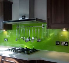Green glass splashbacks as we will have in open plan kitchen, adjacent to the living area