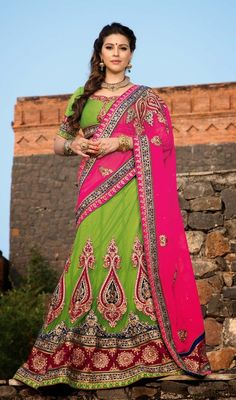Interest oceans of attention adorned in this lime green shade embroidered net lehenga choli. This stunning dress is showing some terrific embroidery done with gold zardosi, patch, resham, stones and velvet patch work. #StunningLehengaCholi