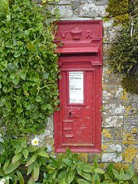 old victorian postbox in wall