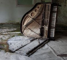 Haunting image of demolished piano in a music school in Pripyat - post Chernobyl '09.