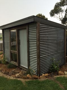 Outdoor shower and storage shed