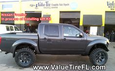 2013 Nissan Frontier getting a lift kit installed by ValueTire in Hollywood, Florida. 954-987-1405.
