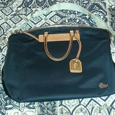 Dooney and bourke nylon satchel Used but in pretty good condition. Does have some pen marks on the inside. The corners are not damaged. The color is black. Dooney & Bourke Bags Satchels