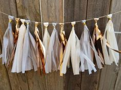 Check out this item in my Etsy shop https://www.etsy.com/listing/518177207/rose-gold-tassel-garland-graduation