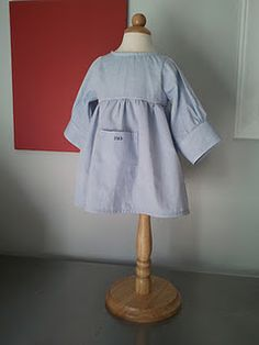 What a fab idea. She makes your husbands old dress shirts into dresses for your little girl :) ADORABLE.