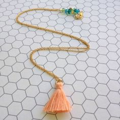 NWT peach tassel gold necklace A simple statement necklace for flying solo or layering with other necklaces. A cute tassel in mango peach hangs from a delicate gold chain. This beauty is closed simply with a gold spring clasp and glass beads, and measures 21 inches. New with tags by Sea Lillie.    All bundles of 3 or more items get a 15% discount & you only have to pay s&h once! Yay! The discount is automatically applied by adding 3+ items to your cart. ☺️  ⭐️ No Trades. ⭐️ Sea Lillie…