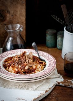 Rich Slow Roasted Pork and Red Wine Ragu by What Katie Ate. Meanwhile shred the pork discarding any fat and add to the sauce, cook for a further 15 minutes until reduced and thick serve with pappardelle pasta and parmesan cheese.