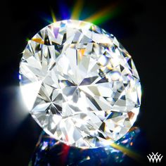 2.565 carat E color VS1 clarity A CUT ABOVE® Hearts and Arrows Super Ideal Round Cut Loose Diamond - Hearts and Arrows Ideal Proportions and a AGS Diamond Report. Price $72,372   www.whiteflash.com