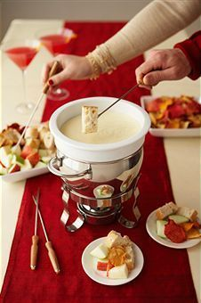 Brie Champagne Fondue: seriously fabulous and works great for the ladies night in. I did modify this somewhat by covering the brie cubes in the cornstartch for easier handling.   Link: http://www.foodnetwork.com/recipes/robert-irvine/champagne-brie-fondue-recipe/index.html