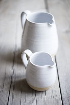 Farmhouse Pottery Pitcher // This piece is fundamental in daily utility. Its hand formed spout and sturdy handle are uniquely crafted.