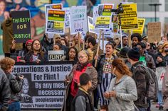 A coalition of NYC Black Lives Matter activists and environmental justice groups gathered at the Harlem State Office Building in New York, to rally and march on the 51st anniversary of the assassination of Malcolm X to demand justice for the people of Flint, Michigan facing a water crisis.