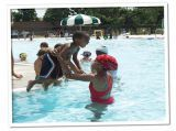 """Sand Park Pool offers a family aquatic attraction - Penguin Pond which features a water slide specially designed for young children along with a wading pool. This pool is """"L"""" shaped ranging from 3 feet to 12 feet deep and has a diving well with two drop slides and a one meter diving board."""