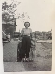 Mother and her two sons, unknown names  Dated July 16 1945